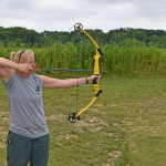 Scioto Grove Assistant Manager Robin Blair uses a compound bow at the static archery course.