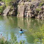 Canoeist on the quarry lake at Quarry Trails Metro Park