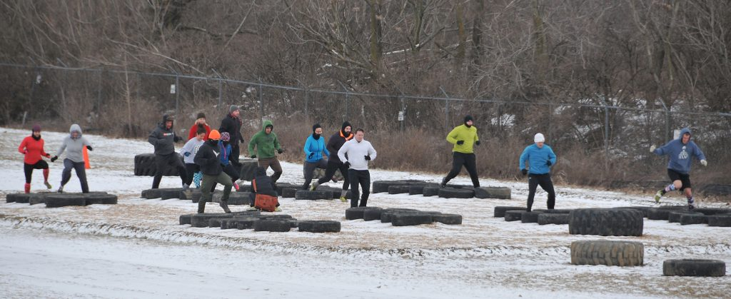Athletes do the tire run on the obstacle course at Scioto Audubon Metro Park