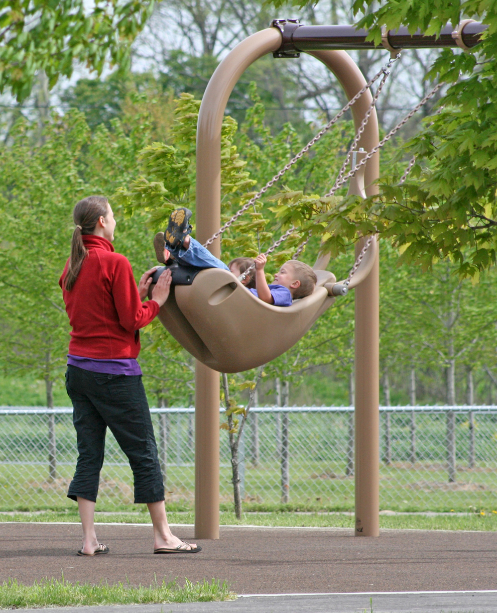 Swinging in the play area in Walnut Woods
