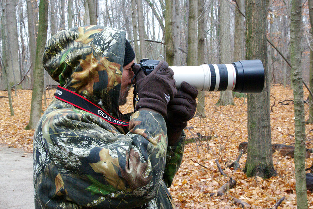 Photographer with long lens at Blacklick Woods Metro Park.