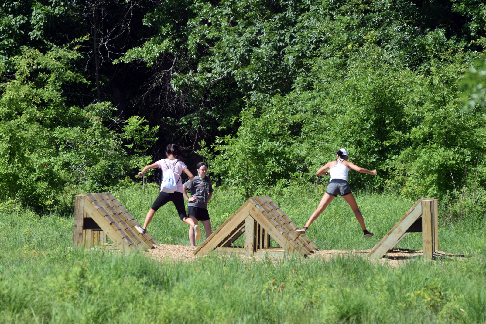 Visitors take on the frog hop on the Challenge Course at Glacier Ridge.