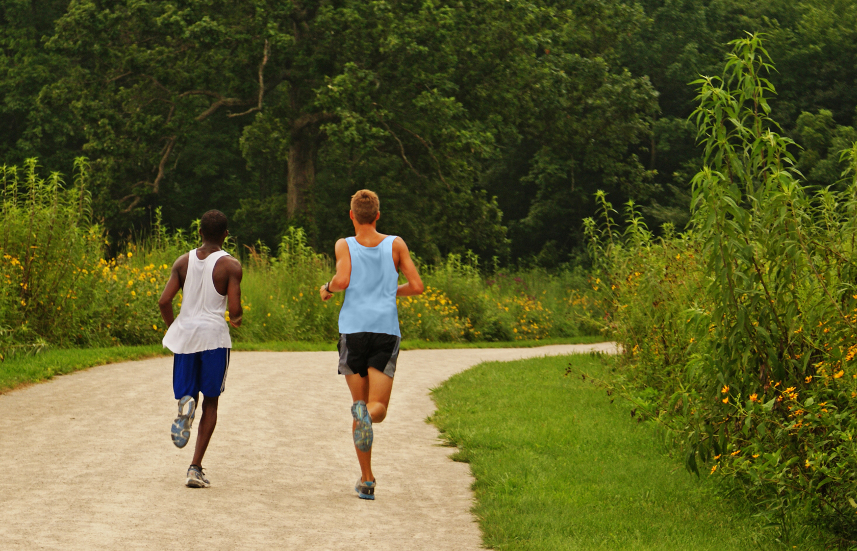 Two boys jogging on Darby Creek Greenway Trail at Battelle Darby Creek Metro Park