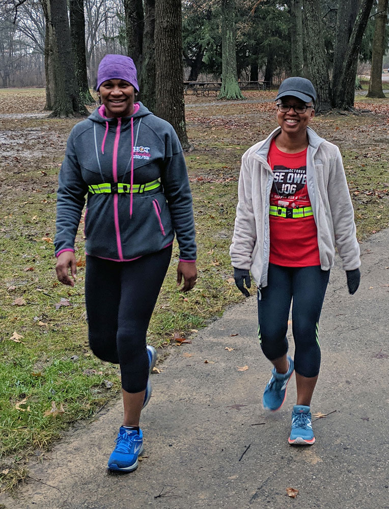Two women walk toward the Beech Trail from Ash Grove parking lot at Blacklick Woods Metro Park.