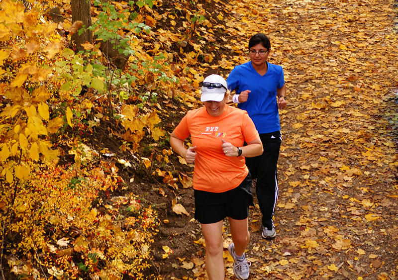 Joggers on the Dripping Rock Trail during the Commit To Be Fit hike at Highbanks