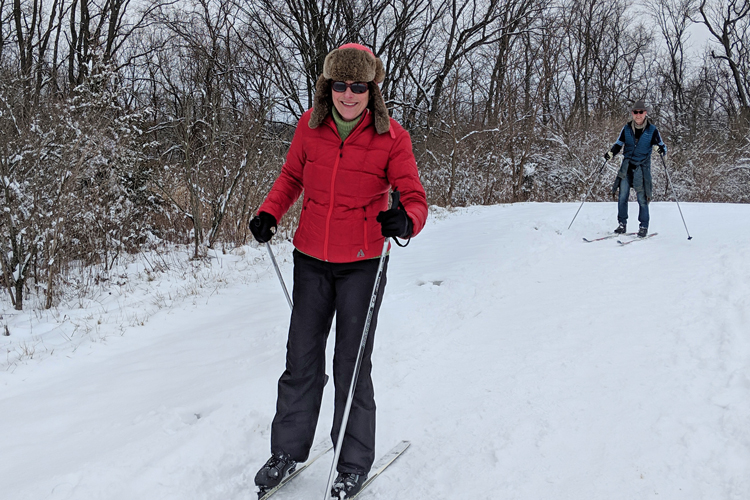 A woman cross country skis on the Darby Creek Greenway Trail at Prairie Oaks Metro Park