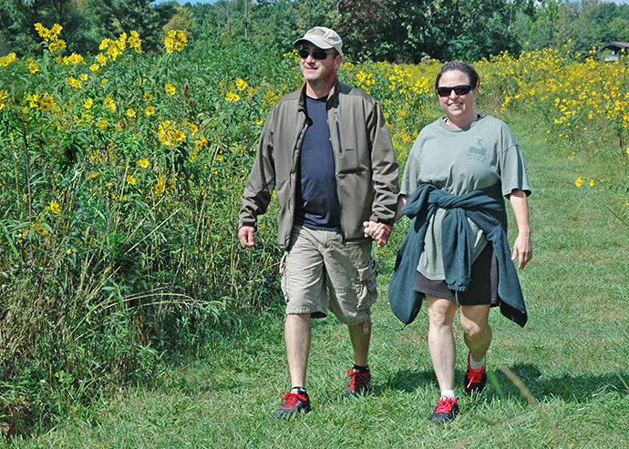 Couple on prairie connector trail at Sharon Woods Metro Park